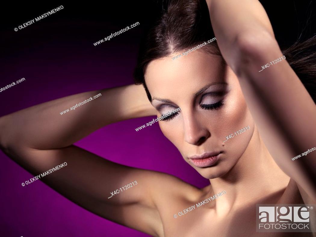 Stock Photo: Beautiful young woman sensual portrait.