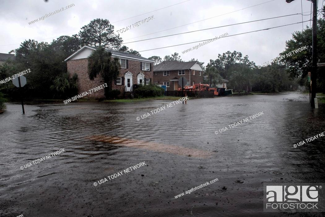 Stock Photo: Flooding at the intersections of Wentworth and Barre Streets in Charleston, SC during Hurricane Dorian Thursday, September 5, 2019.