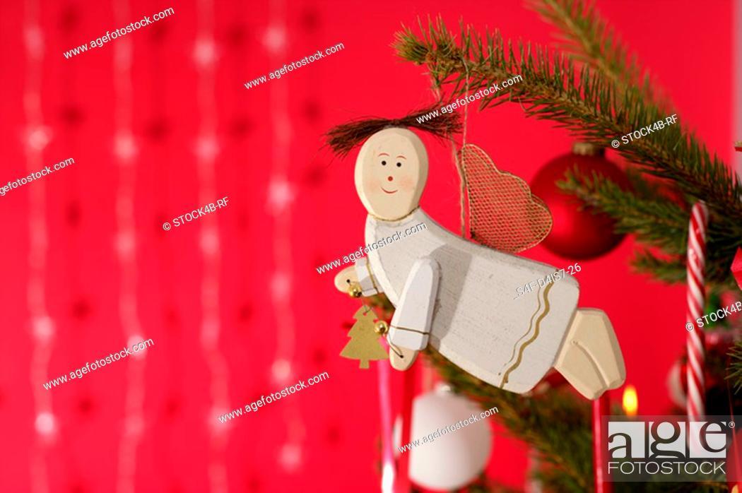 Stock Photo: Christmas angle on Christmas tree.