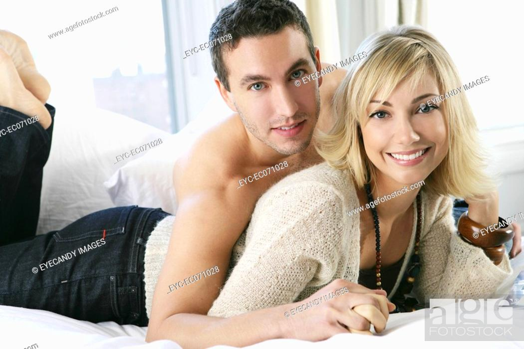 Stock Photo: Young happy couple in bed.