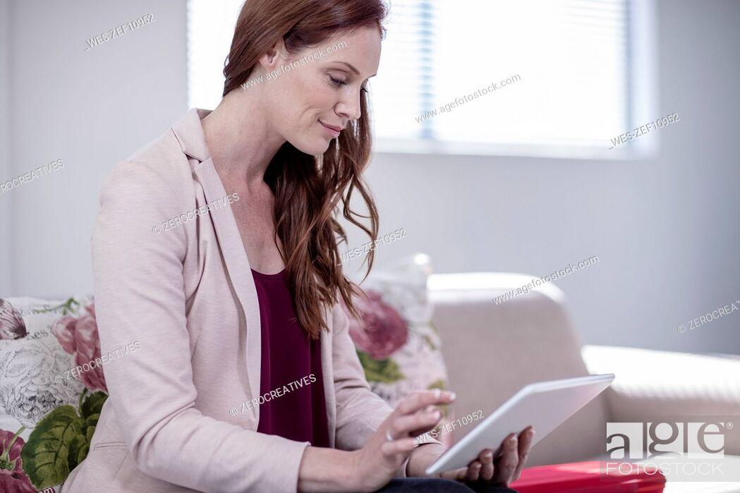 Photo de stock: Successful businesswoman working in office.