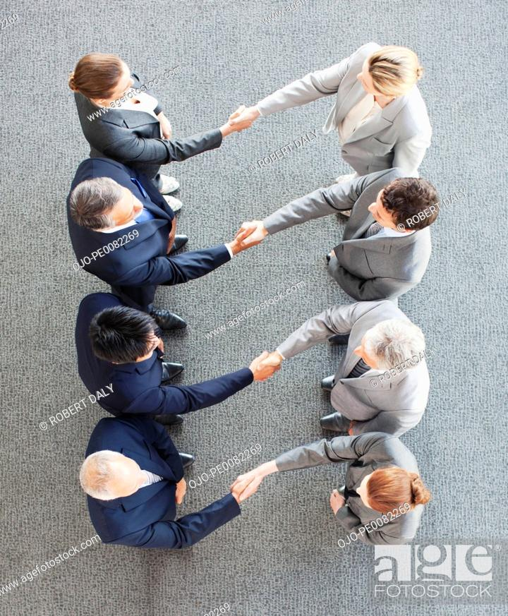 Stock Photo: High angle view of business people shaking hands in a row.