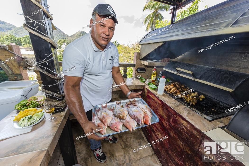 Stock Photo: Fresh caught fish being prepared at a private restaurant in Nueva Gerona on Isla de la Juventud, Cuba.