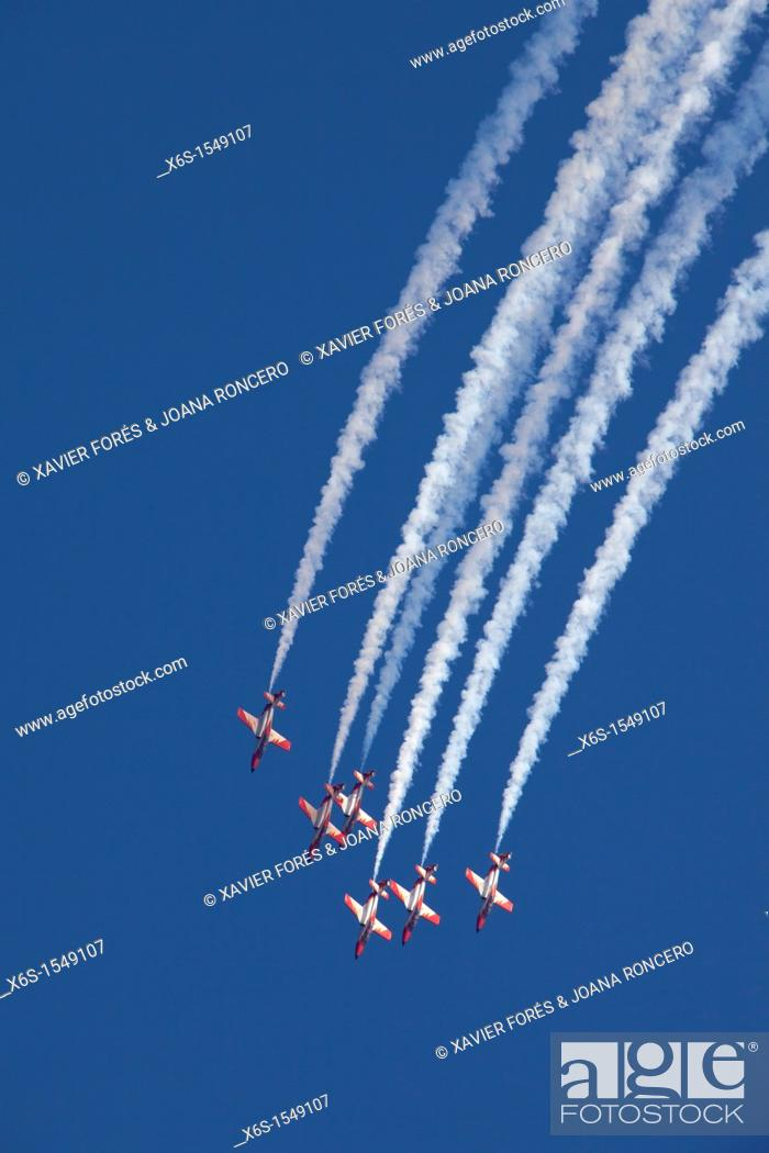 Stock Photo: Airshow of the Patrulla Aguila from Spanish Air Force, Festa al Cel 2011, Barcelona, Spain.