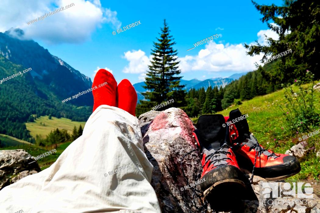 Imagen: Red hiking boots on a hike in the mountains of Austria.Activity during leisure time.