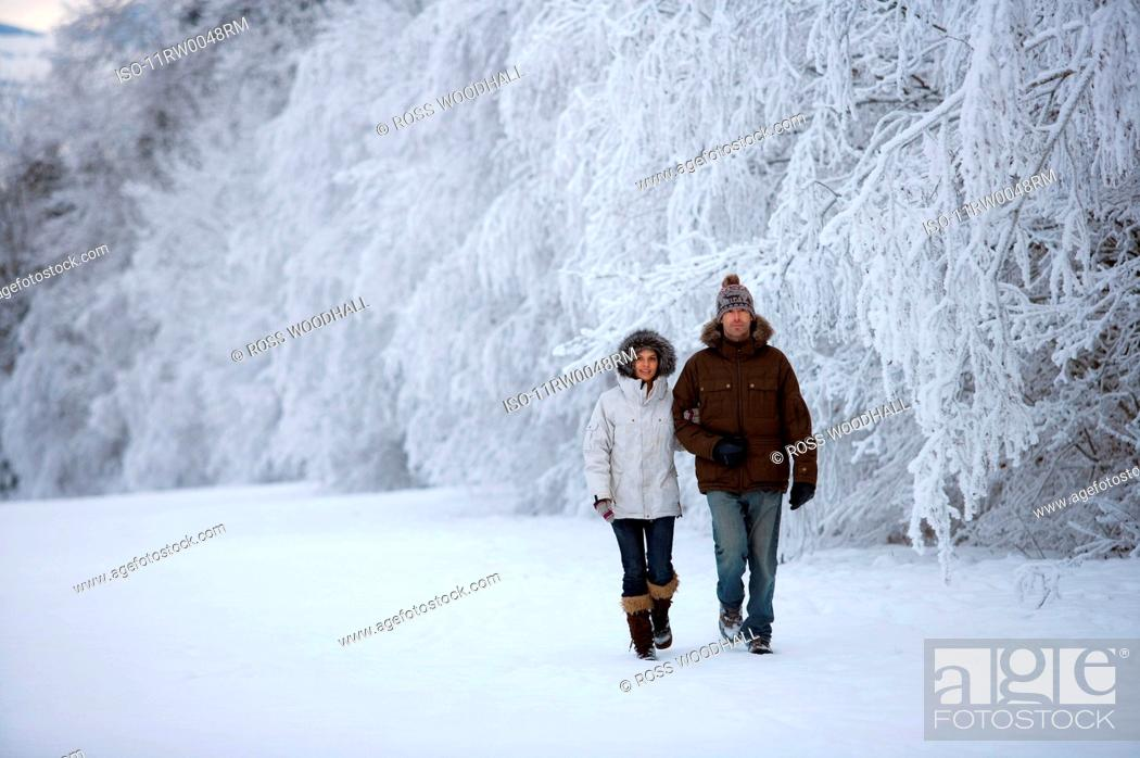 Stock Photo: Couple walking in the snow.