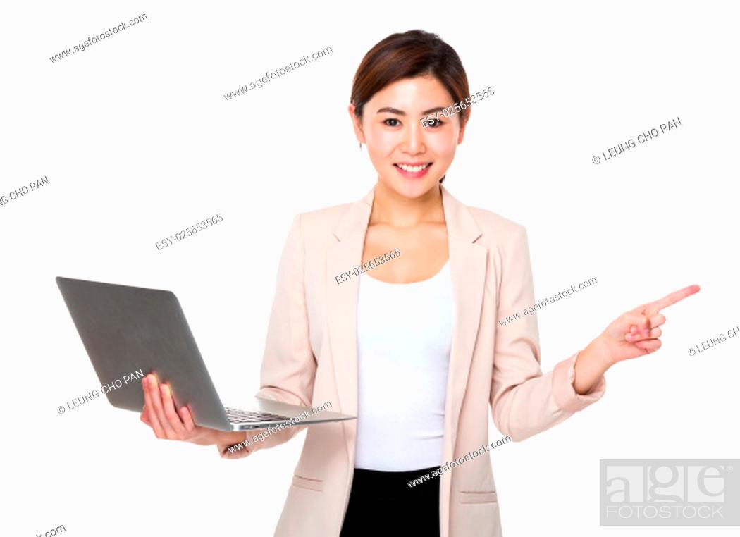 Stock Photo: Businesswoman hold with laptop and and finger aside.