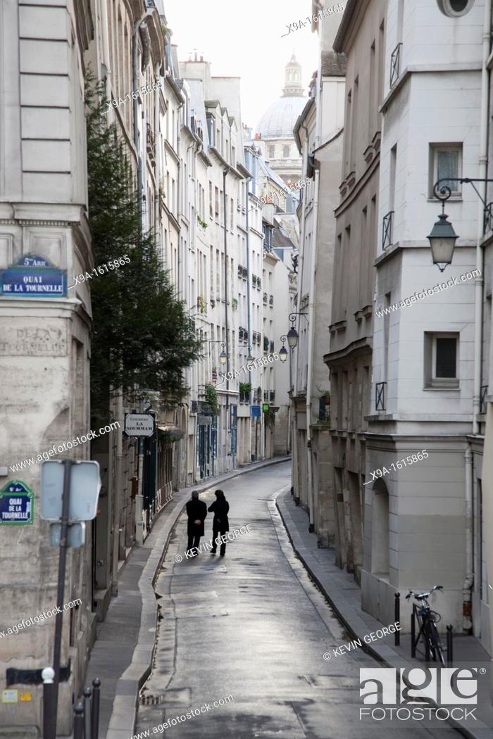Stock Photo: People walking down Rue de Bievre, Paris.