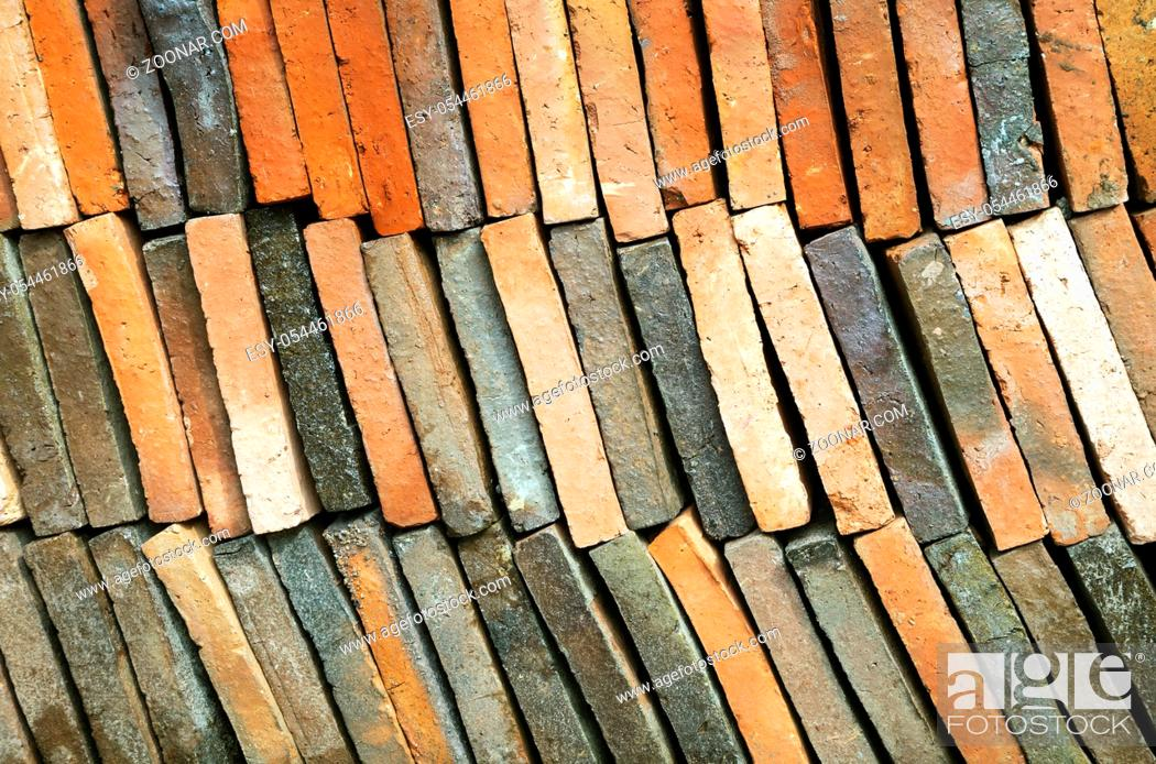 Stock Photo: Background of old clay tiles in a pile for roof construction.