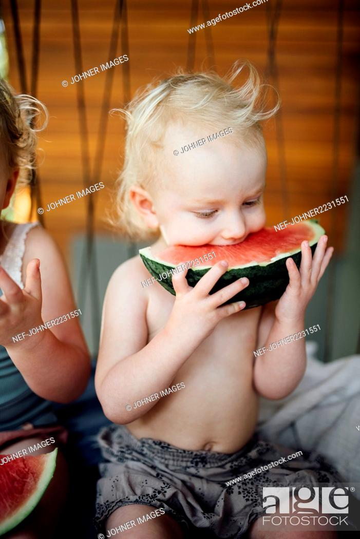 Stock Photo: Brother and sister eating watermelon.