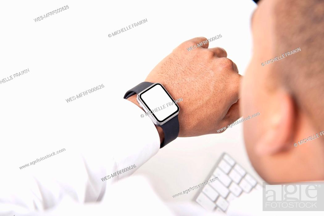 Stock Photo: Man looking at his smartwatch, close-up.