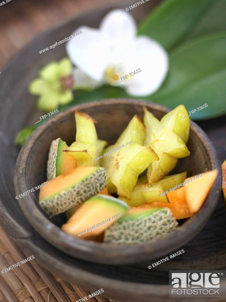Stock Photo: melon,Carambola and orchids.
