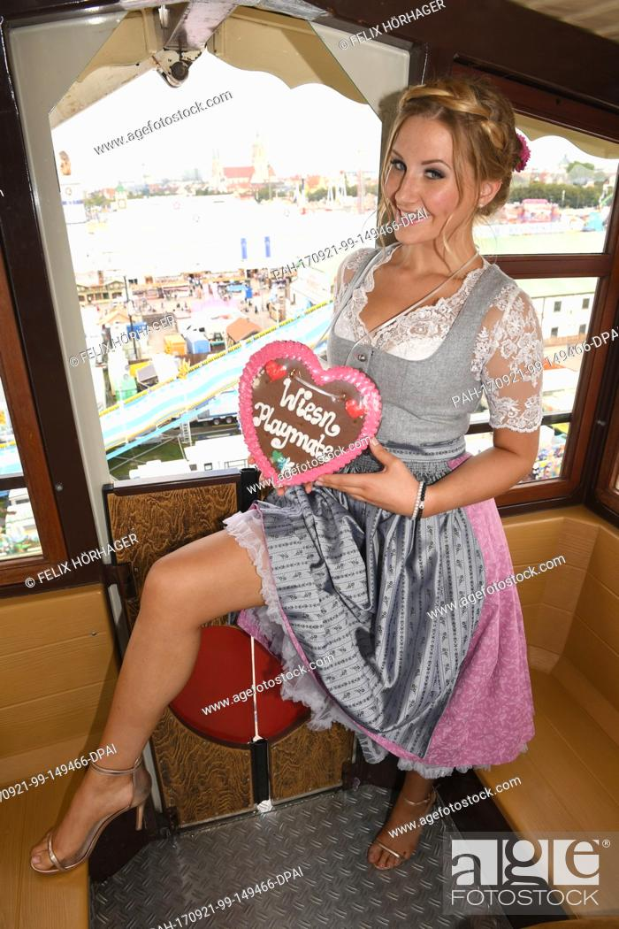 Stock Photo Dpa Exclusive Wiesn Playmate Patrizia Dinkel Posing In A Gondola Of The Big Wheel At Oktoberfest In Munich Germany
