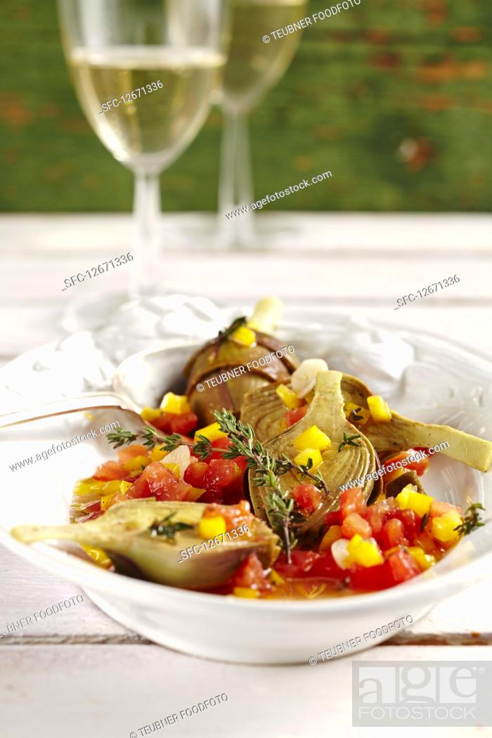 Stock Photo: Young pickled artichokes with tomatoes, peppers, vinegar, oil, lemon, white wine and spices.