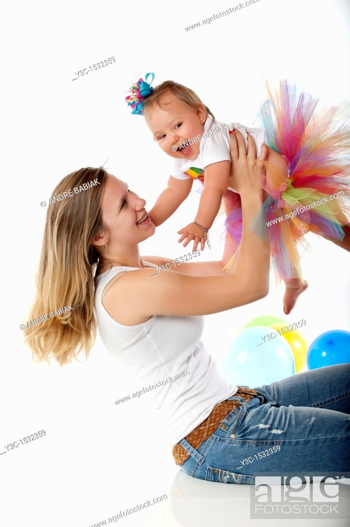 Stock Photo: Very young mother with baby girl.