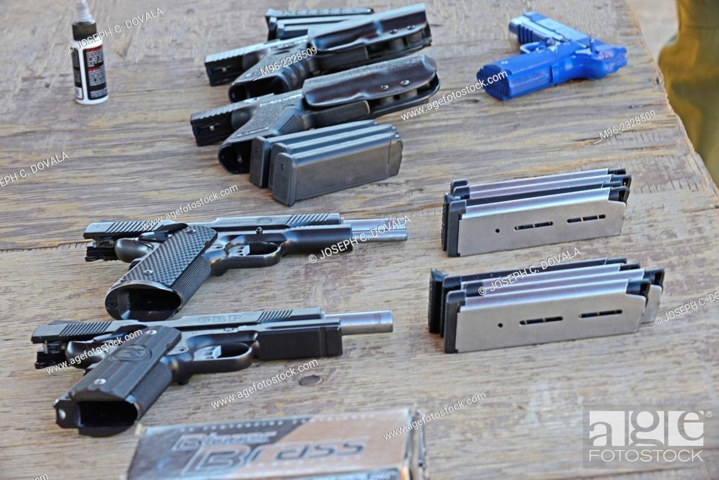Stock Photo: Unloaded pistols on bench, outdoor shooting range, Santa Clarita, California, USA.