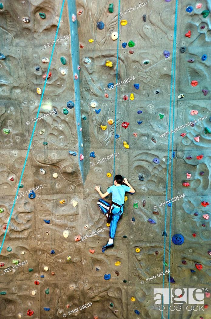 Stock Photo: Boy scaling an indoor rock climbing wall  Atlanta, Georgia.