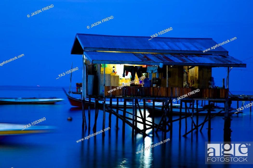 Stock Photo: Sabah Malaysia, Borneo, Mabul Island  Water village on Mabul Island near Sipadan, viewed at dusk.
