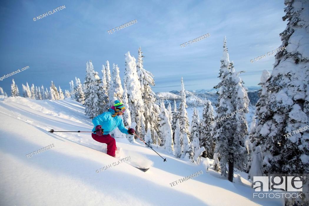 Stock Photo: Mature woman speeding on ski slope.