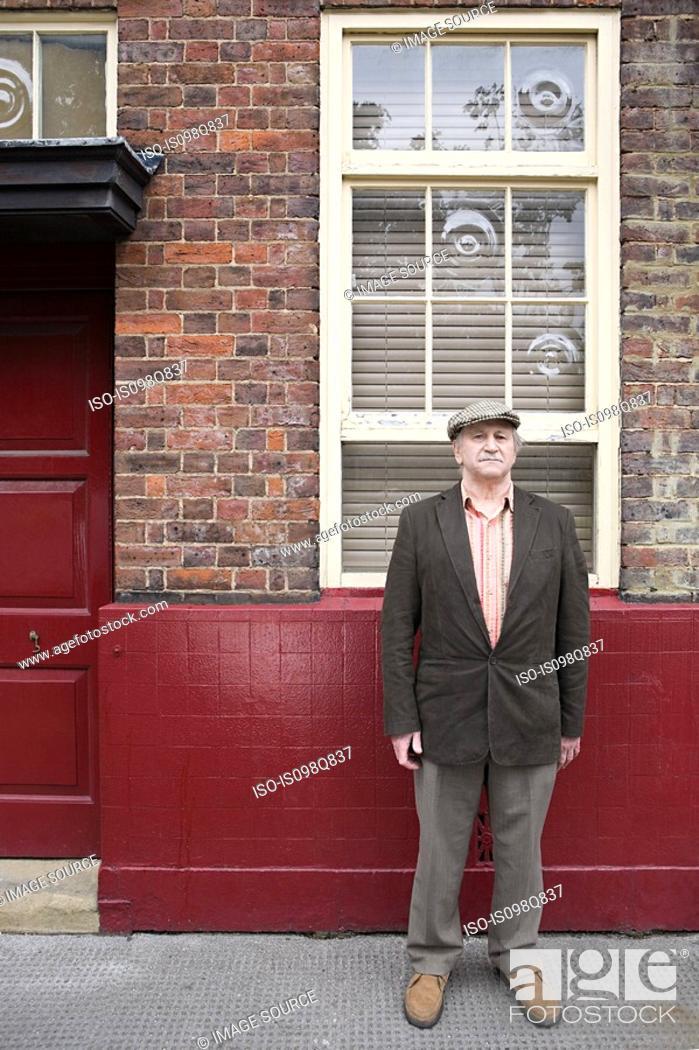Stock Photo: Senior man outside building.