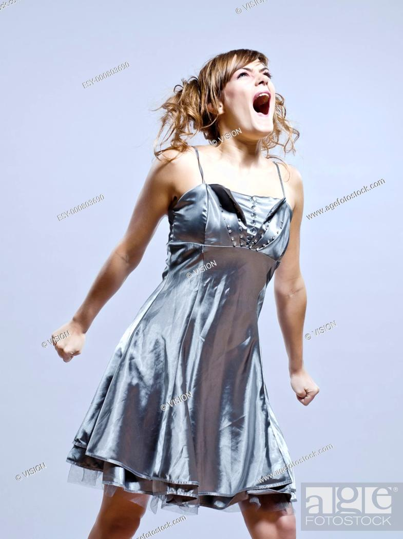 Stock Photo: beautiful young caucasian woman girl evening dress screaming angry on studio isolated plain background.