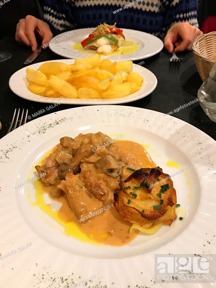 Stock Photo: Meat with mushrooms sauce and grilled potatoes.