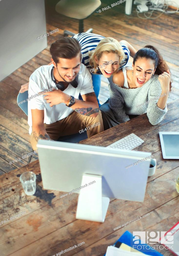 Stock Photo: Young adult friends using computer.