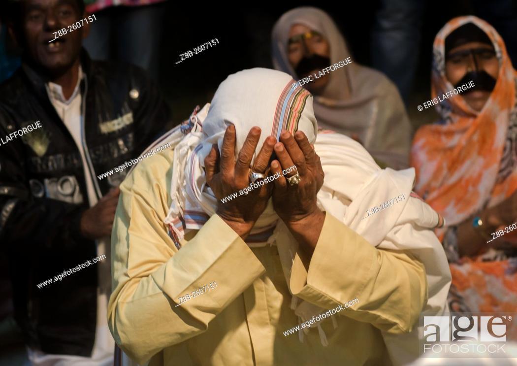 Stock Photo: Iran, Qeshm Island, Salakh, man praying during a zar ceremony.