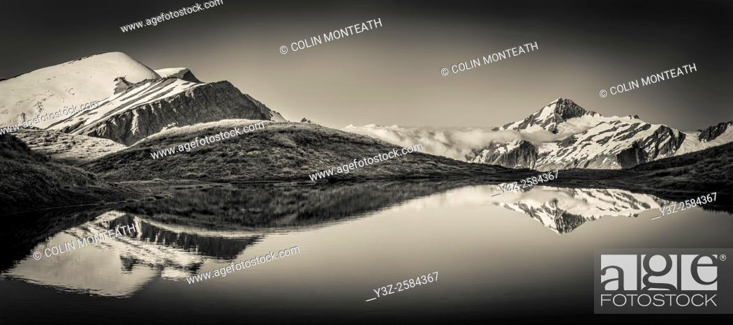 Stock Photo: Mt Aspiring reflection in tarn, Cascade Saddle, Mount Aspiring National Park, Otago, New Zealand.
