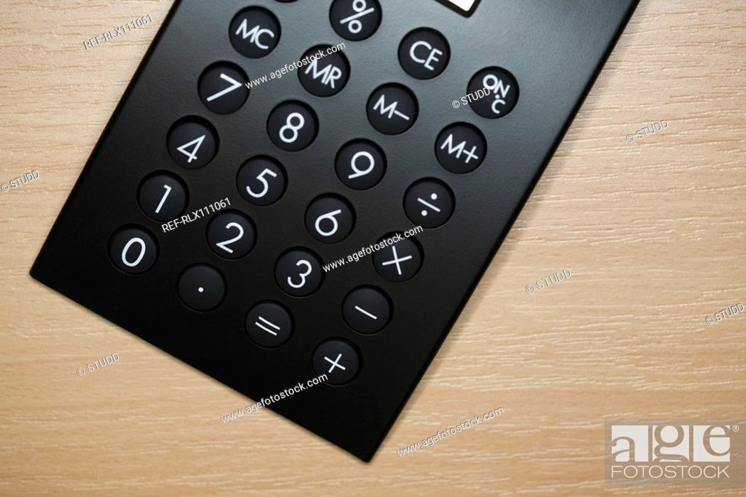 Stock Photo: Close up of black calculator from above.