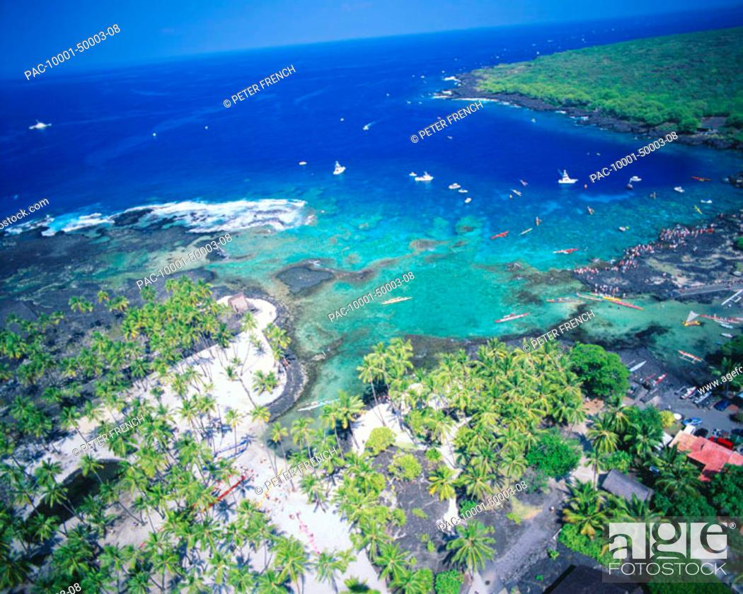 Stock Photo - Hawaii, Big Island, Honaunau, Puu honua, Aerial view of Queen  Liliuokalani canoe race with escort boats.