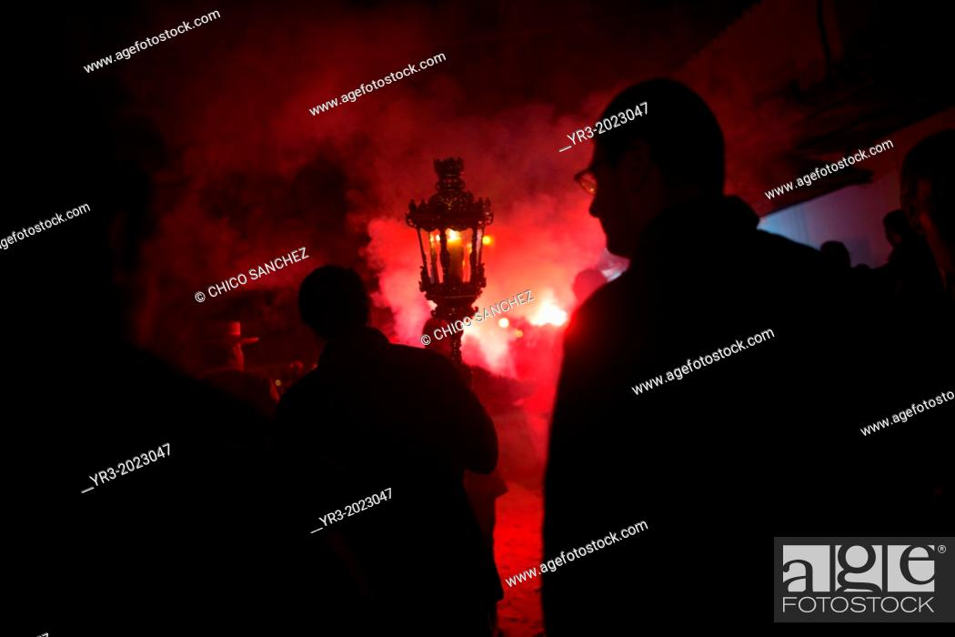 Stock Photo: Pilgrims are illuminated by flares during the rosary of the pilgrimage to the shrine of the Virgin of Rocio, in Almonte, Donana National Park, Huelva province.