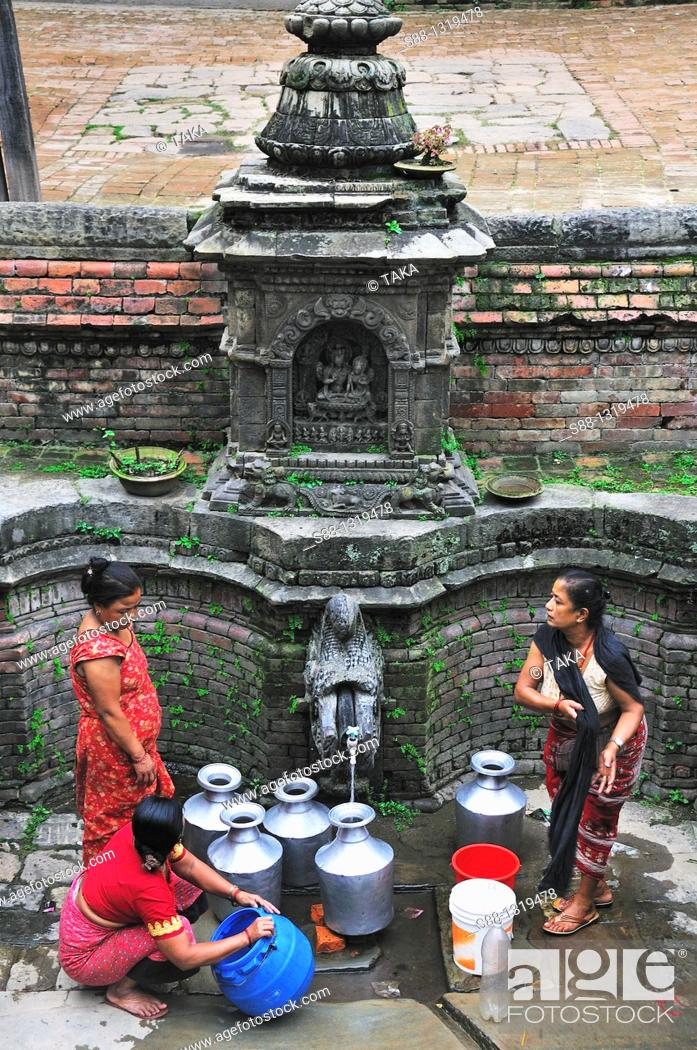 Stock Photo: People come to get water at Durbar square, Bhaktapur (Bhadgaon), Kathmandu Valley, Nepal.