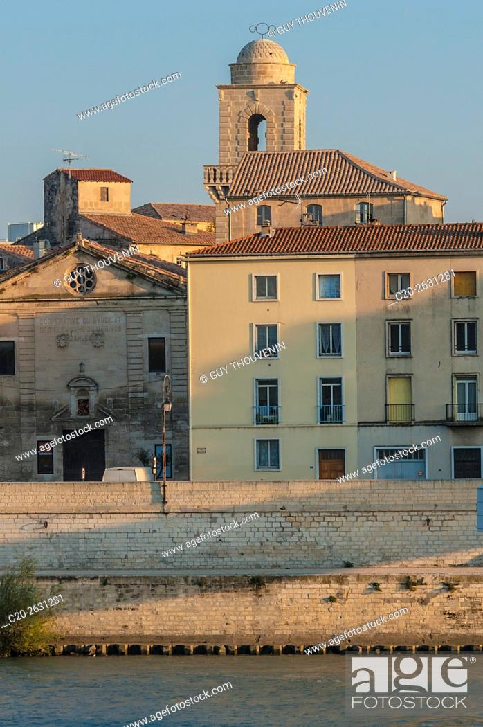 Stock Photo: Saint Trophime church tower and Mejan quarter seen from Trinquetailles, acroos Rhone river, Arles, 13, Provence, France.