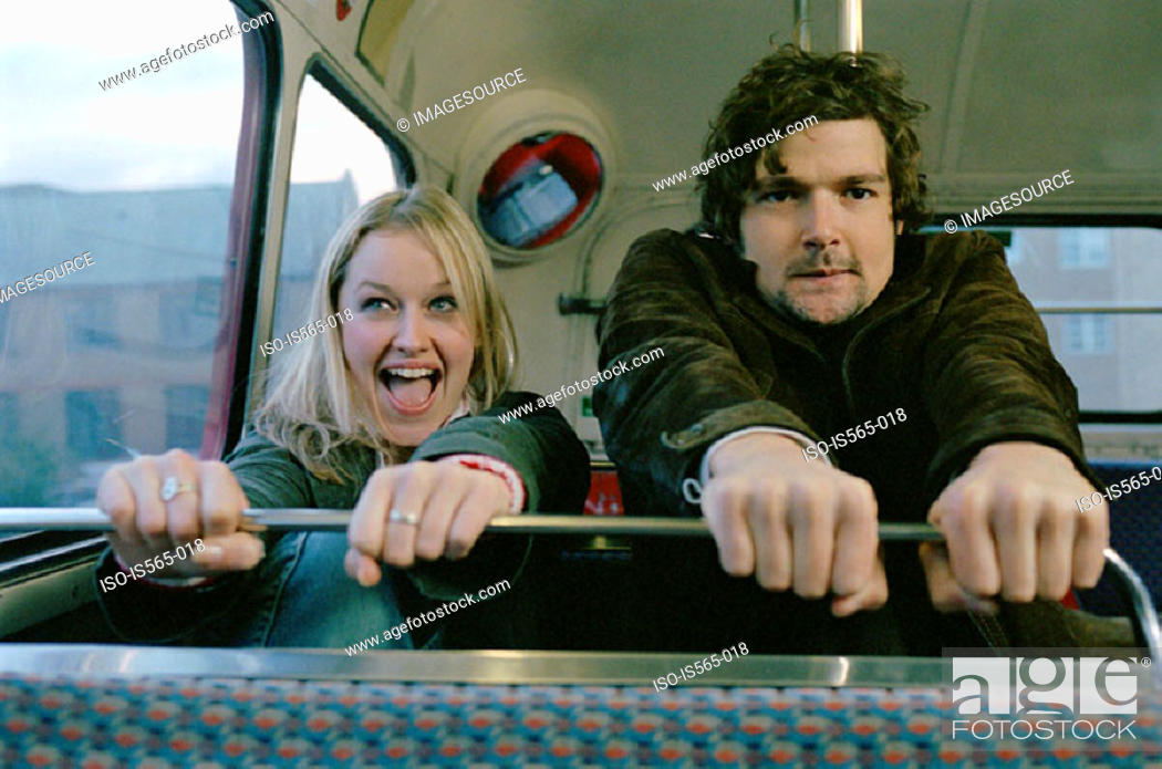 Stock Photo: Couple grasping bus seat.