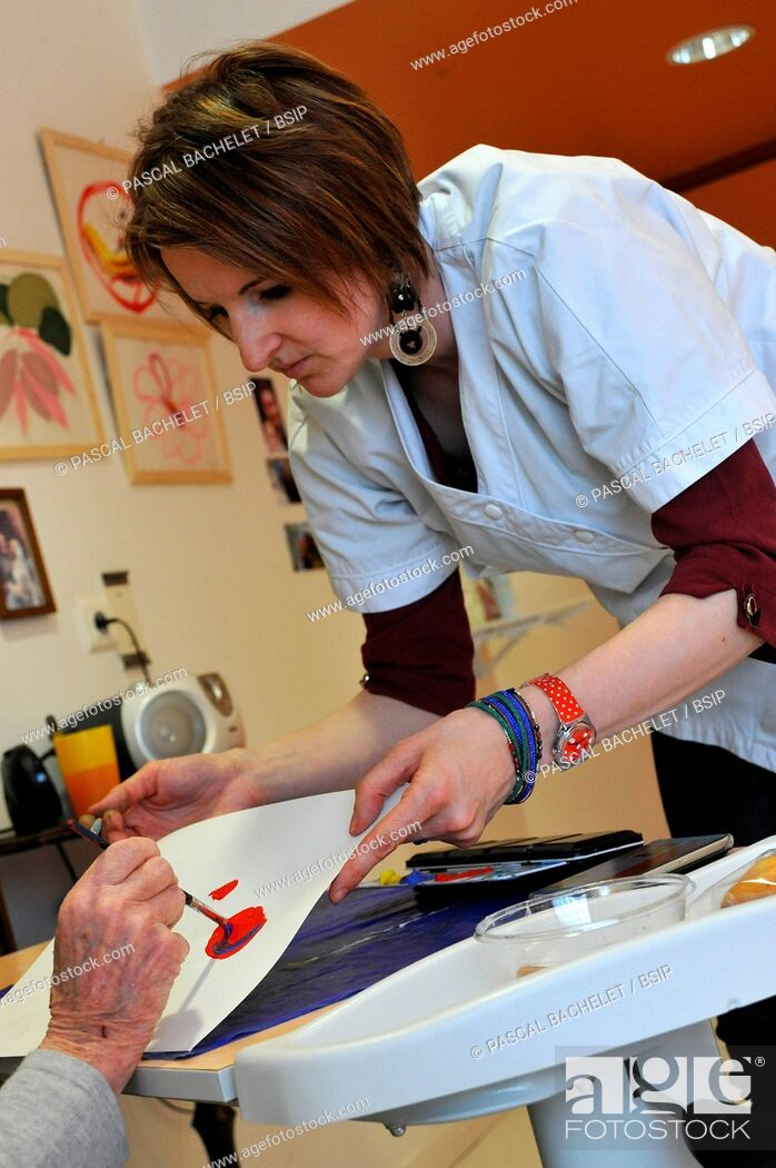 Stock Photo: Reportage on art therapy in Ham hospital?s Alzheimer's unit, France. Art therapy sessions are offered to residents in order to maintain or rehabilitate their.