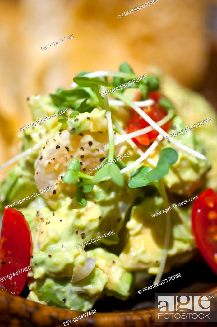 Stock Photo: fresh avocado and shrimps salad with nachos on side.
