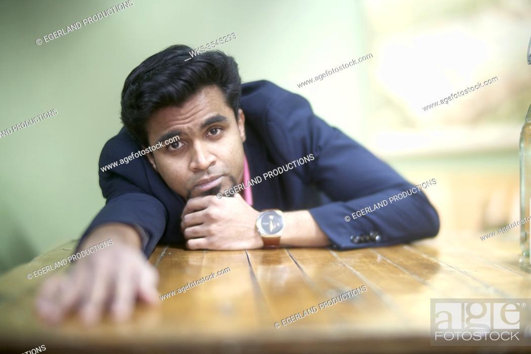 Stock Photo: Indian man feeling melancholy.