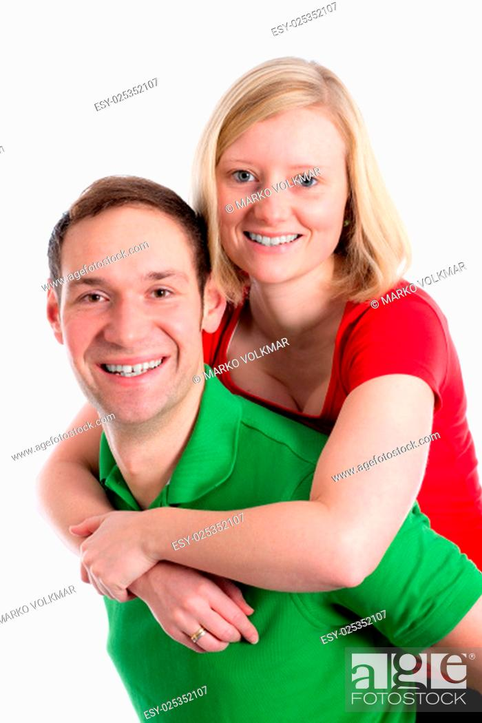 Stock Photo: young couple in an embrace in front of white background.
