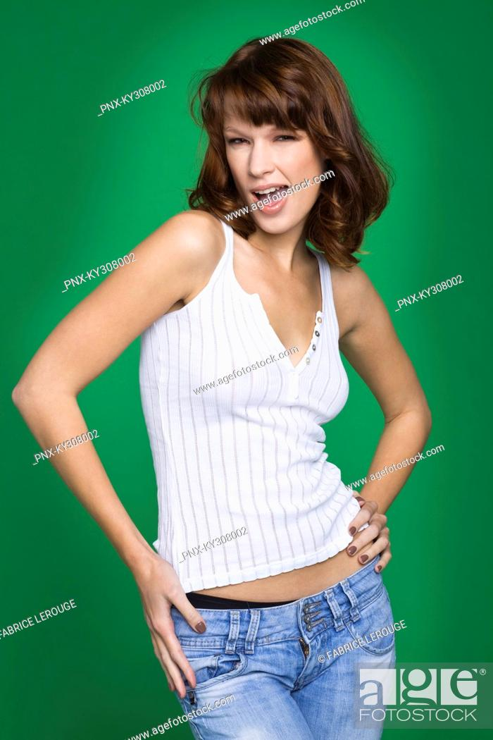Stock Photo: Young woman in tank top and jeans.