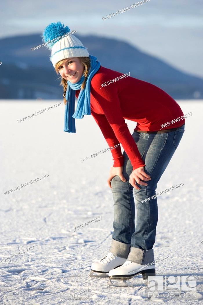 Stock Photo: Austria, Salzkammergut, Lake Irrsee, Female teenager 14-15 on skates, smiling.