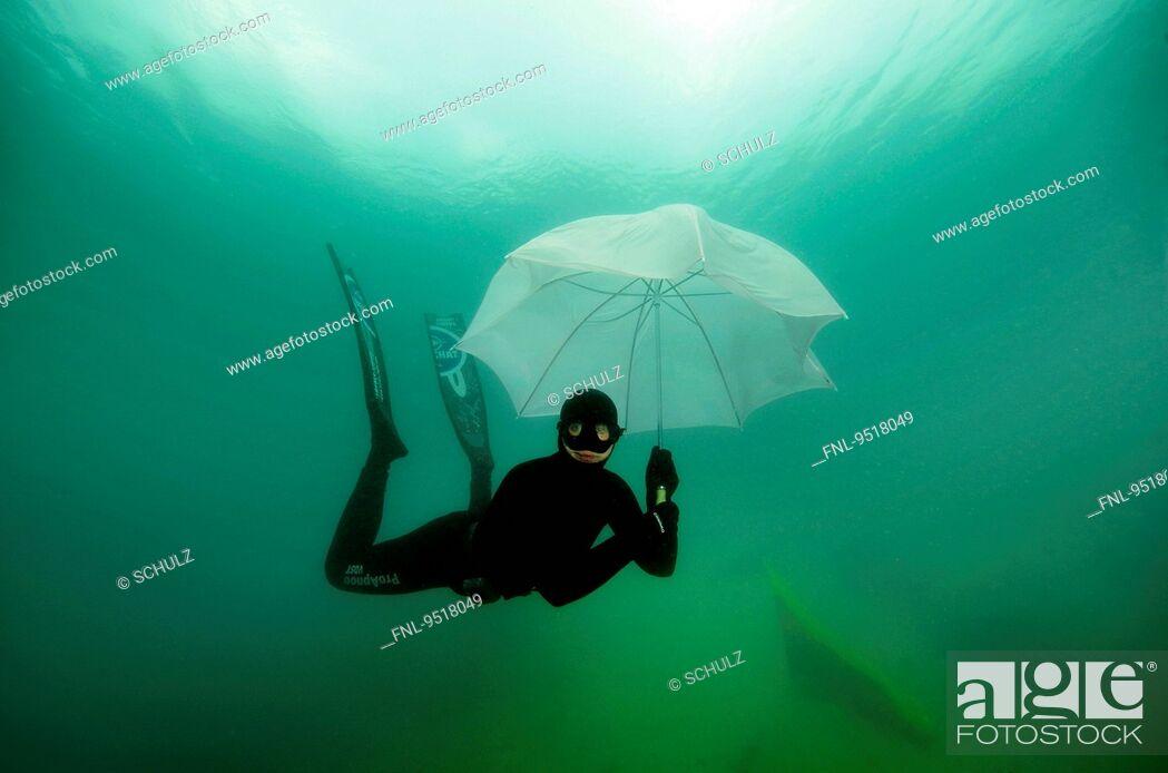 Stock Photo: Female diver, Hemmor, Lower Saxony, Germany, Europe.