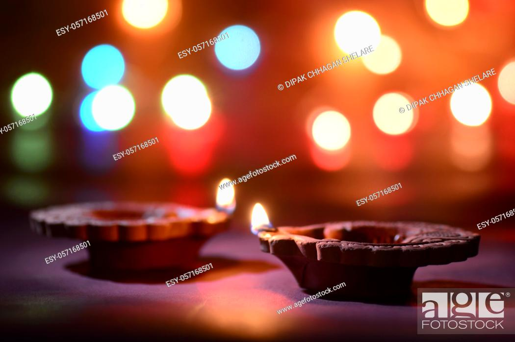 Stock Photo: Clay diya lamps lit during Diwali Celebration. Greetings Card Design Indian Hindu Light Festival called Diwali.