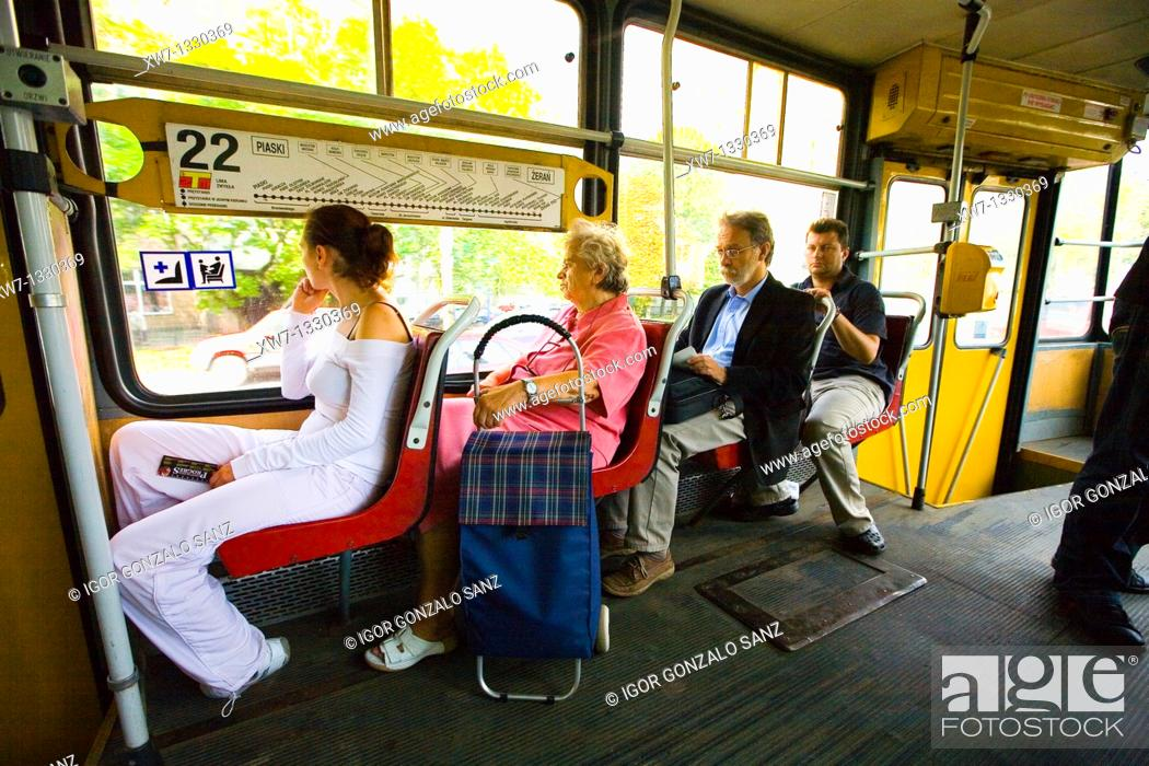 Stock Photo: Polish people inside the tram car races around the city of Warsaw, Poland.