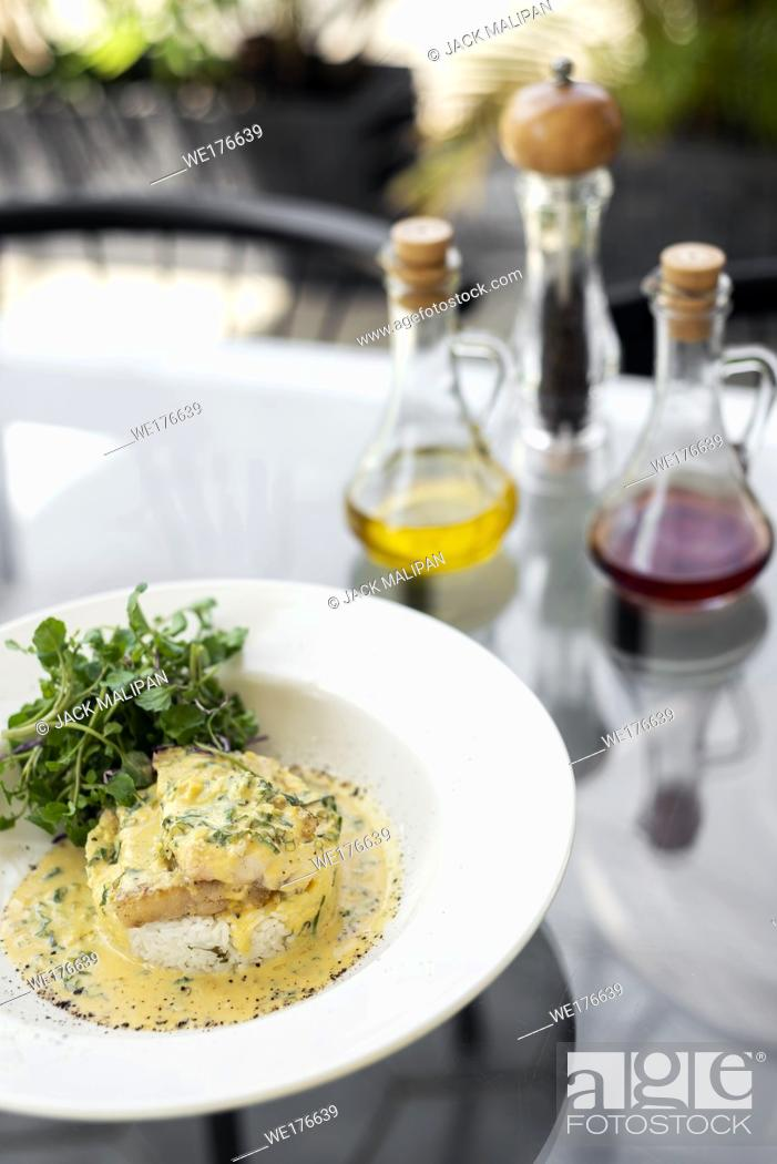 Stock Photo: sea bream fish fillet in creamy mustard dill and lemon sauce restaurant meal on plate.