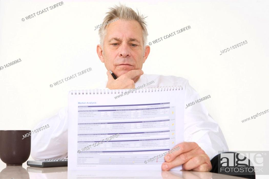 Stock Photo: Businessman Holding Paperwork.