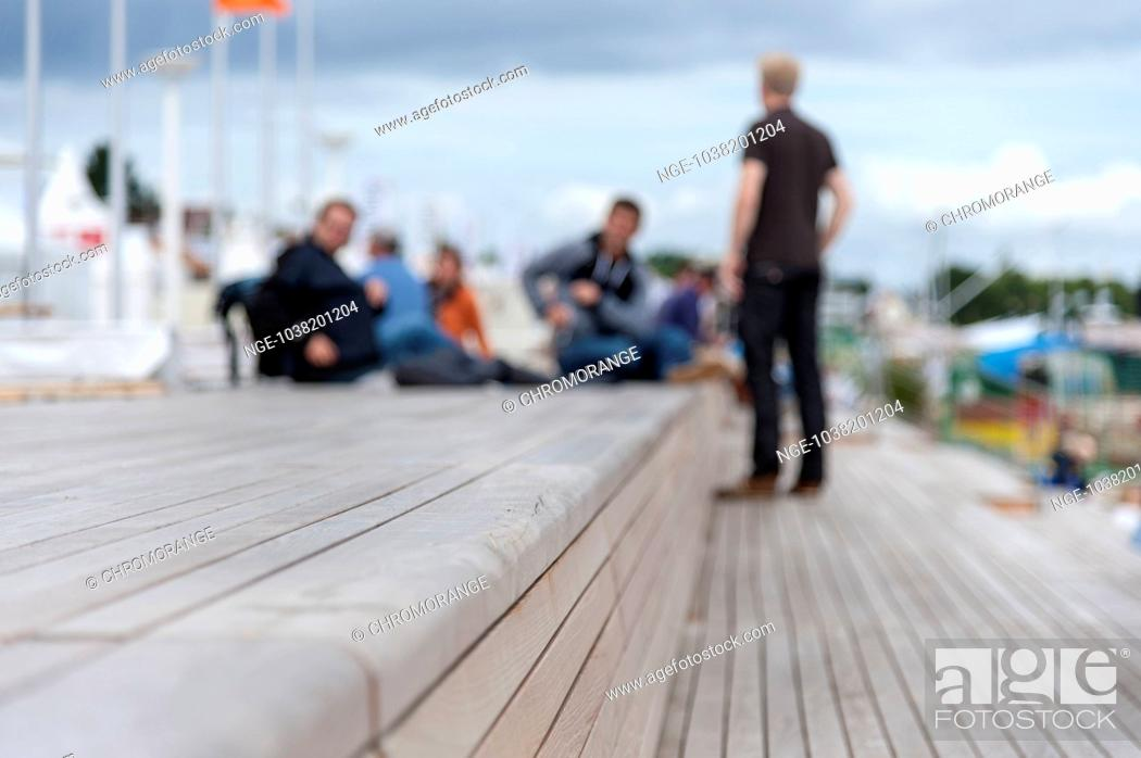 Outstanding A Group Of People Sitting On Wooden Benches At The Beach Bralicious Painted Fabric Chair Ideas Braliciousco
