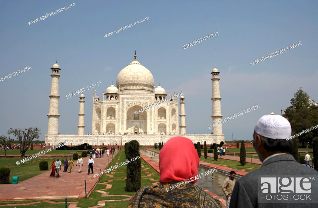 Stock Photo: Kashmiri couple viewing at Taj Mahal Seventh Wonders of World on the south bank of Yamuna river , Agra , Uttar Pradesh , India UNESCO World Heritage Site.
