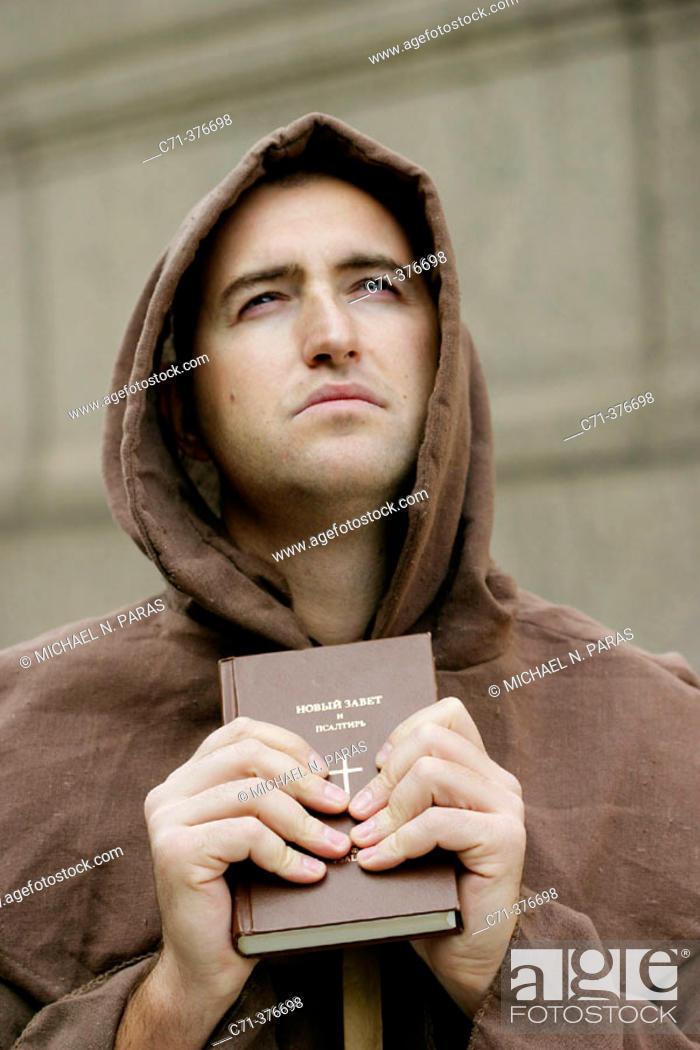 Photo de stock: Monk. Priest holding Bible.