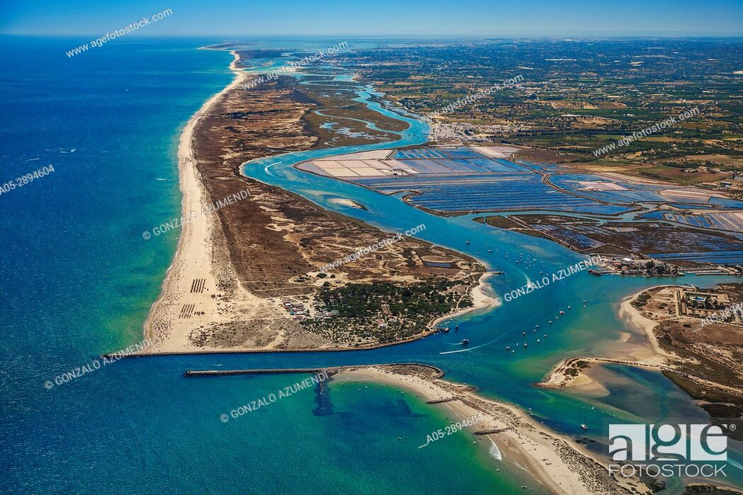 Stock Photo: Tavira Canal, Tavira island and Saltpans of Tavira. Ria Formosa, natural park. Faro district. Algarve. Portugal.